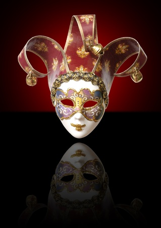 One venetian mask on a black background