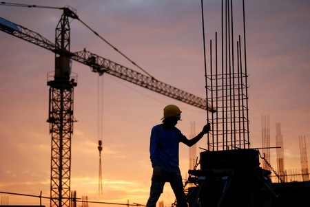 Photo for Black silhouette of the building construction is not finished. - Royalty Free Image