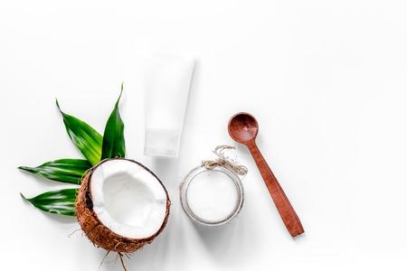 Photo pour Body treatment. Coconut oil and cream on white background top view copyspace - image libre de droit