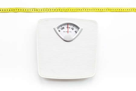 Photo pour Bathroom scale and measuring tape on white background top view - image libre de droit