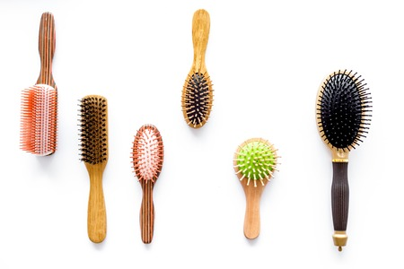 Set of combs in beauty salon on white background top view