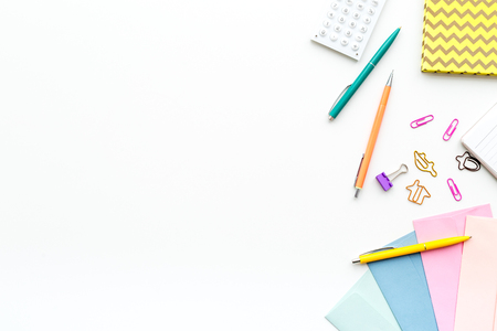 Photo pour Scattered stationery on student's desk. White background top view. - image libre de droit