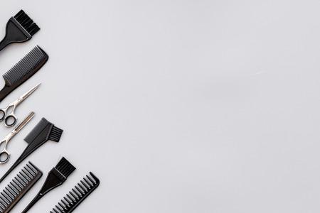 Foto de Beauty saloon equipment. Hairdress and haircut. Combs, sciccors, brushes on grey background top view. - Imagen libre de derechos