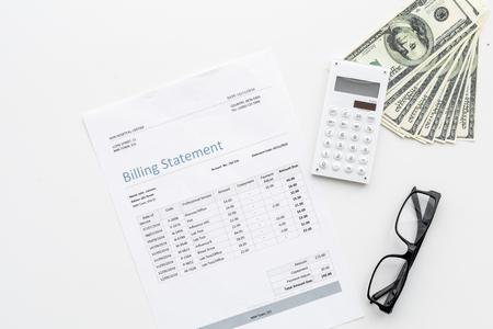 Pay bills and taxes. Billing statement, calculator, money on white background top view.