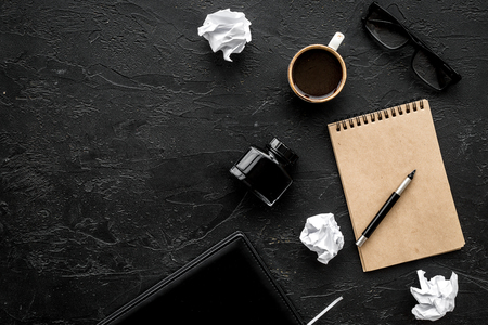 Photo for Retro and modern writer desktop with cup of coffee, notebook and ink on black table background top view mock up - Royalty Free Image