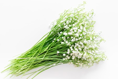 Photo pour May flowers. Bouquet of lily of the valley flowers on white background top view. - image libre de droit