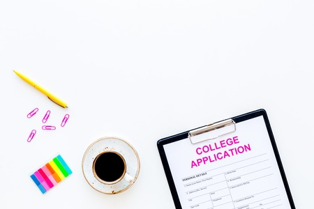 Apply college. Empty college application form near coffee cup and stationery on white background top view.