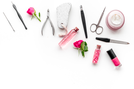 Foto de manicure tools set for nail care on white desk background top view mock up - Imagen libre de derechos