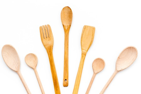 Photo pour Village table with wooden cutlery set on white background top view - image libre de droit