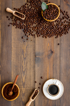 Foto de coffee background with beans and cup of americano wooden table flat lay space for text - Imagen libre de derechos