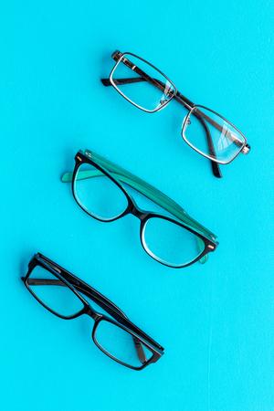 Photo pour Set of glasses with transparent lenses on blue background top view - image libre de droit