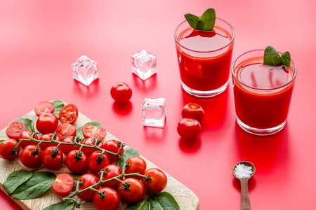 Foto de Tomato juice for summer healthy drink on red table background - Imagen libre de derechos