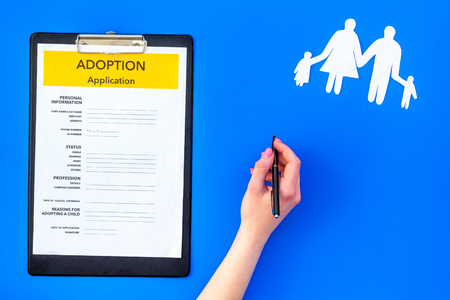 Photo pour Family and adoption child concept with application on blue table background top view - image libre de droit