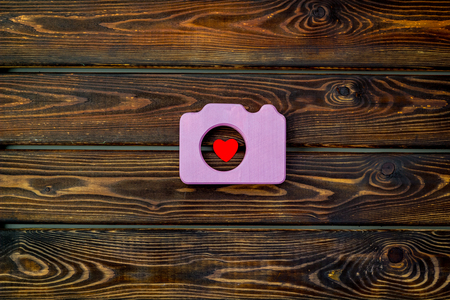 Photo for Photo camera concept with heart on wooden background top view. - Royalty Free Image