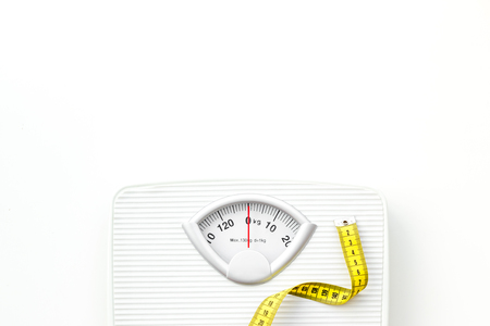 Photo for Proper nutrition. Medical starvation. Slim concept with scale and measuring tape on white background top view mockup - Royalty Free Image