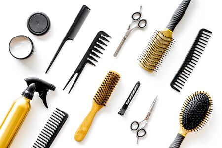 Photo pour Combs, scissors and hairdresser tools in beauty salon work desk on white background top view pattern - image libre de droit