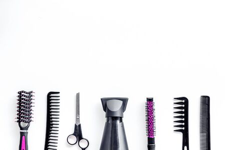 Photo for Hair cut concept. Professional pink accessories of hairdresser on work desk white background top view copyspace - Royalty Free Image