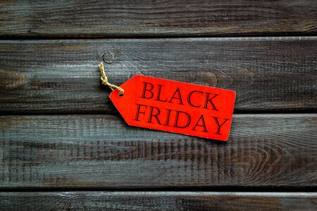 Photo for Discounts with black Friday label on wooden desk background top view - Royalty Free Image