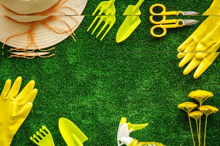 Photo for Gardening tools frame on green grass background top view space for text - Royalty Free Image