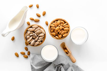 Photo pour Almond milk in glass with almonds on white background top view - image libre de droit