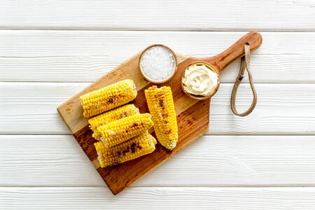 Photo pour Grilled corn with salt and butter as farm food on white wooden background top view - image libre de droit