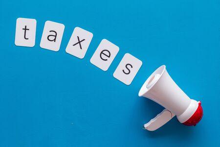 Photo pour announce with taxes copy and megaphone on blue background top view - image libre de droit