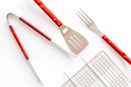Photo for Grid, tongs, fork, spatula for barbecue and grill on white background top view - Royalty Free Image