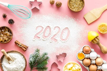 Photo for Happy New Year concept. 2020 written on pink baking background top view - Royalty Free Image