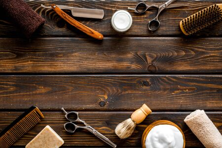 Photo pour Barbershop concept. Hairdressing tools on dark wooden background top view space for text - image libre de droit