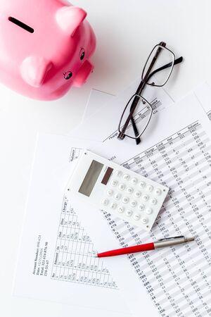 Photo pour Taxes payment concept. Financial documents, piggy bank, calculator on white background top view. - image libre de droit
