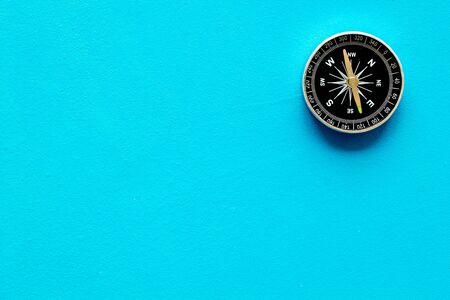 Photo for Compass - small and stylish - on blue background top view copy space - Royalty Free Image