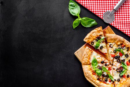 Photo for Pizza with tomato, basil, olives, cheese on black background top view space for text - Royalty Free Image