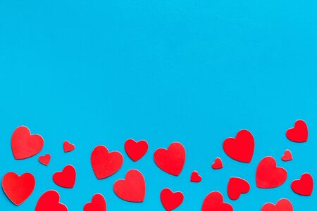 Photo for Valentine's Day design. Red hearts frame on blue background top-down. - Royalty Free Image