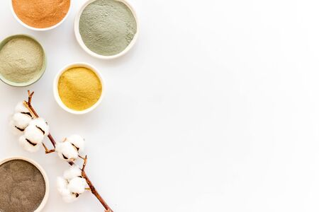Photo pour Yellow, red, white, blue and black cosmetic clay on white table top view copy space - image libre de droit