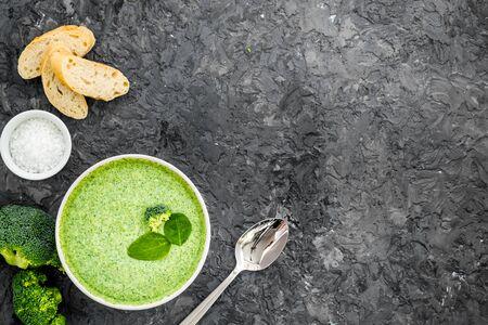 Foto de Broccoli cream soup on grey kitchen table top view copy space - Imagen libre de derechos