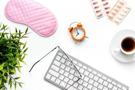 Photo pour fatigue concept. Sleep mask on white office desk from above - image libre de droit