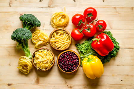 Photo for Grocery shopping set with vegetables and herbs, top view - Royalty Free Image