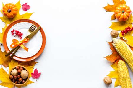 Photo pour Thanksgiving holidays concept with dishes and pumpkins, top view - image libre de droit
