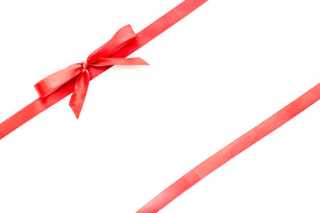 Photo pour Red ribbon with bow isolated on white. Top view. Copy space - image libre de droit