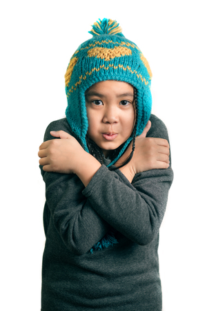 Foto de portrait of adorable happy child cold girl in warm hat , isolated on white - Imagen libre de derechos