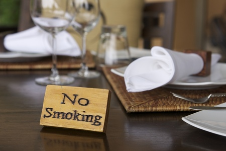 wooden no smoking sign on restaurant table