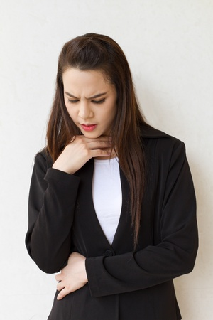 sick woman with throat problem