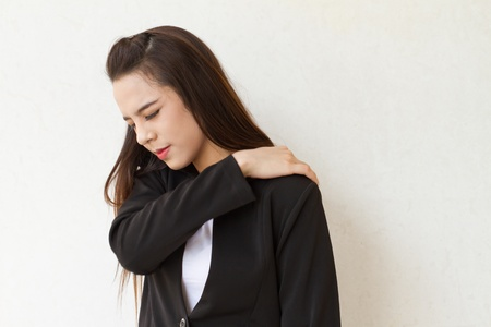 shoulder pain or stiffness of female business executive, concept of mild office syndrome at beginning stage