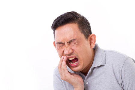 man suffering from toothache, tooth sensitivity