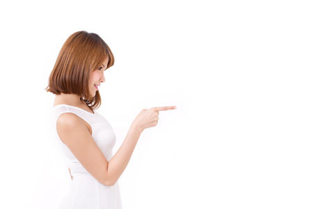 woman pointing up to blank spaceの写真素材