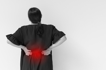 woman suffering from back pain, spinal injury, muscle issue problem