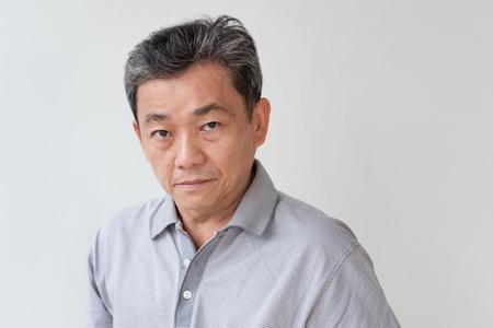 Foto de angry, upset, unhappy, frustrated, unfriendly middle age old asian man looking at you - Imagen libre de derechos
