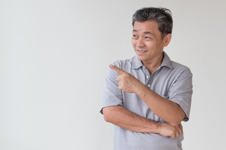 Photo pour old, middle aged, senior asian man looking and pointing finger away gesture - image libre de droit