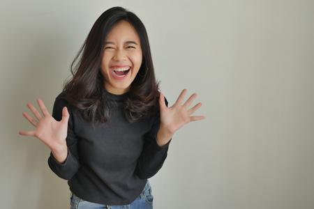 Photo pour happy excited asian woman laughing - image libre de droit