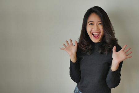 Photo for happy excited asian woman laughing - Royalty Free Image
